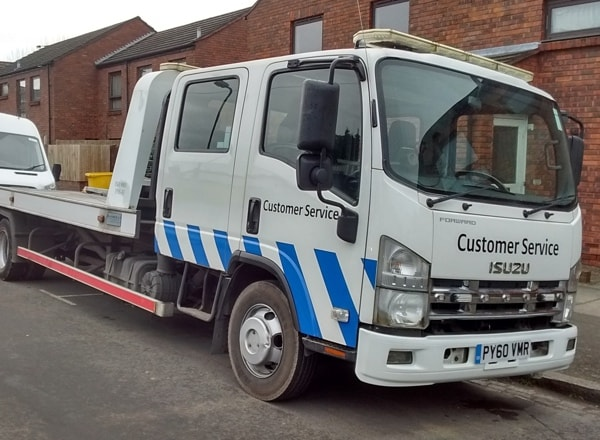 Isuzu Forward used for vehicle transportation, van and car breakdown recovery service in London
