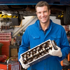 Mechanic carrying out MINI service at a MINI Garage in London SW19